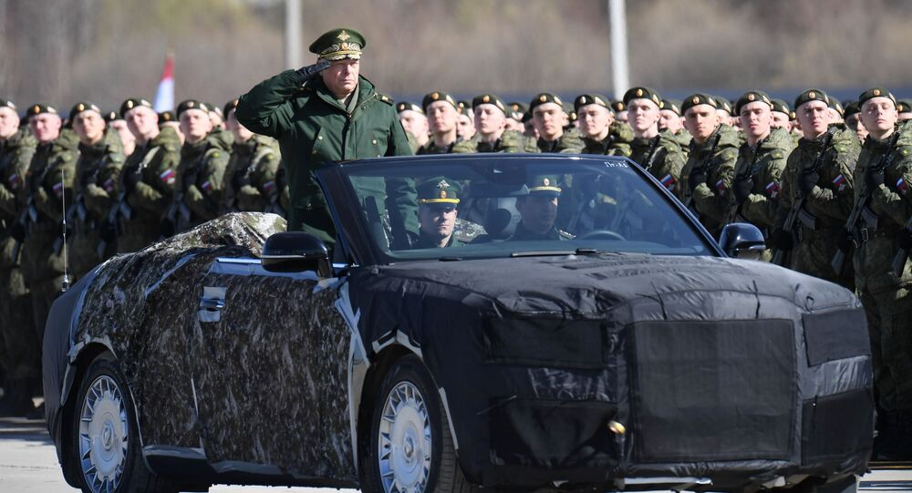 Commander-in-Chief of the Russian Ground Forces Army General Oleg Salyukov in the Aurus convertible