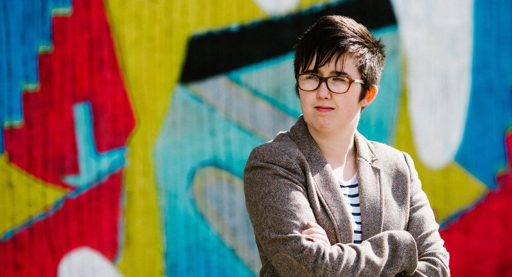 A handout picture released by Jess Lowe Photography on April 19, 2019 and taken on May 19, 2017 shows journalist and author Lyra McKee posing for a photograph in Belfast