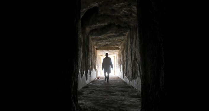 An Egyptian archaeologist walks inside one of the largest newly discovered pharaonic tombs Shedsu Djehuty in Luxor, Egypt April 18, 2019