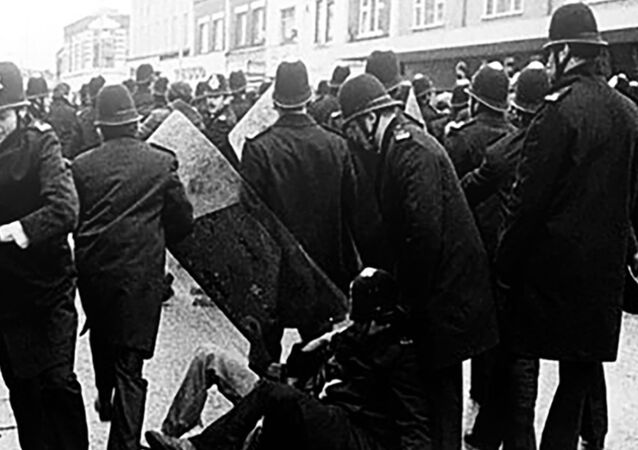 Police arresting a man in Southall on 23 April 1979