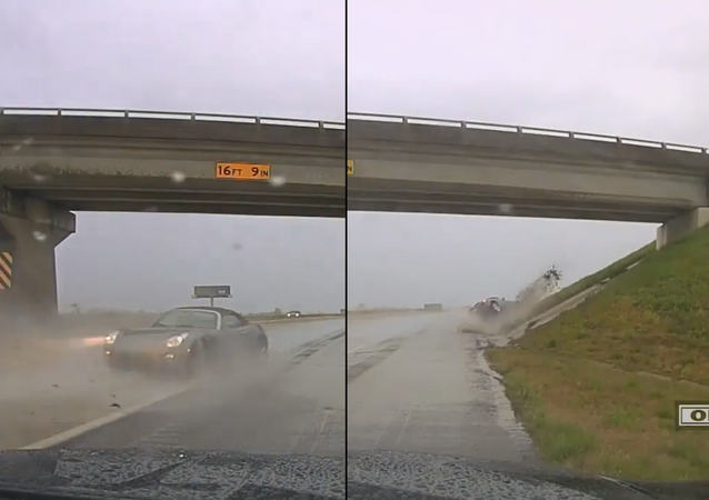 US Teen Hydroplanes in Sports Car, Almost Strikes Highway Patrol Officer