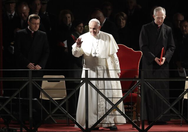 Pope Francis salutes as he arrives during the Via Crucis (Way of the Cross) torchlight procession in front of Rome's Colosseum on Good Friday, a Christian holiday commemorating the crucifixion of Jesus Christ and his death at Calvary, in Rome, Friday, April 19, 2019.