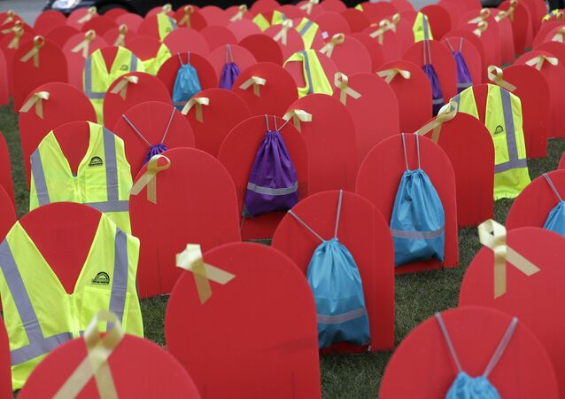 Red mock tombstones designating some of the more than 1,000 people who took their lives by suicide in Washington state in 2017 are displayed on a grassy area near the Legislative Building, Tuesday, March 12, 2019, at the Capitol in Olympia, Wash