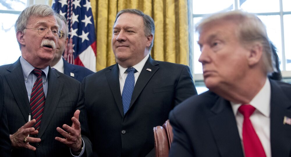 From left, National Security Adviser John Bolton, accompanied by Secretary of State Mike Pompeo and President Donald Trump