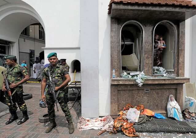 Sri Lankan military officials stand guard in front of the St. Anthony's Shrine, Kochchikade church after an explosion in Colombo, Sri Lanka, 21 April, 2019