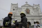 Sri Lankan firefighters stand in the area around St. Anthony's Shrine after a blast in Colombo, Sri Lanka, Sunday, April 21, 2019.