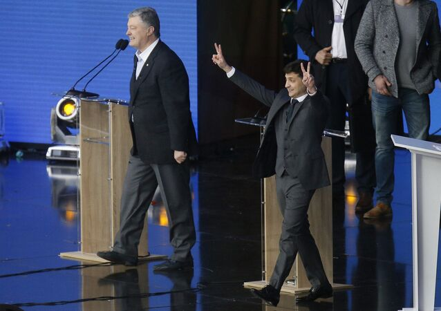 Presidential candidates, Ukrainian President Petro Poroshenko, left, and popular comedian Volodymyr Zelenskiy attend debates in the weekend presidential run-off at the Olympic stadium in Kiev, Ukraine
