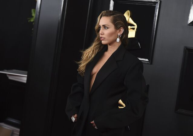 Miley Cyrus arrives at the 61st annual Grammy Awards at the Staples Center on Sunday, Feb. 10, 2019, in Los Angeles