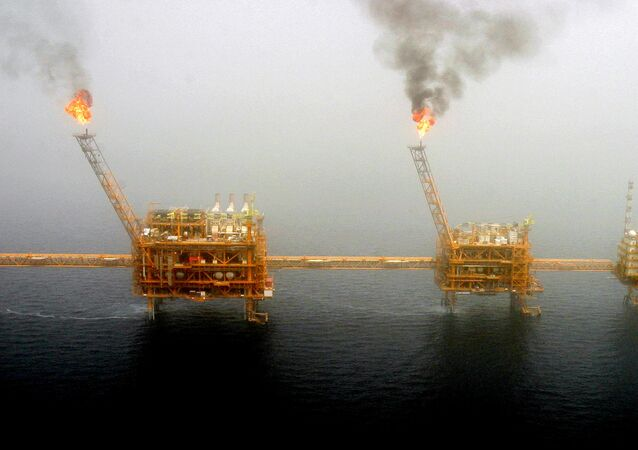 Gas flares from an oil production platform at the Soroush oil fields in the Persian Gulf, south of the capital Tehran, July 25, 2005