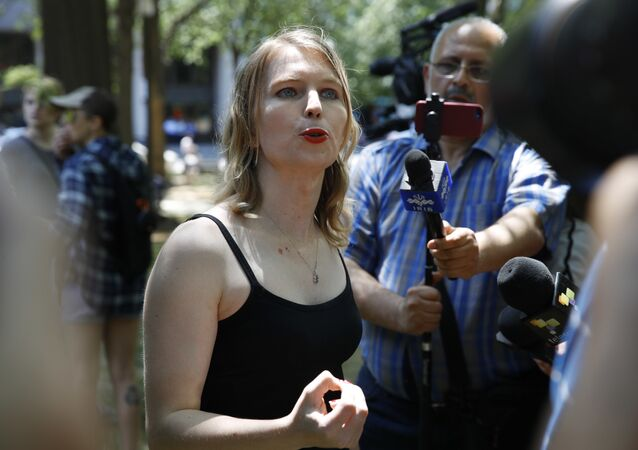 Chelsea Manning speaks to the media after attending a rally in support of the J20 defendants, Friday, May 11, 2018, in Washington. Protesters want charges dropped against defendants who face multiple felonies relating to Inauguration day protests.