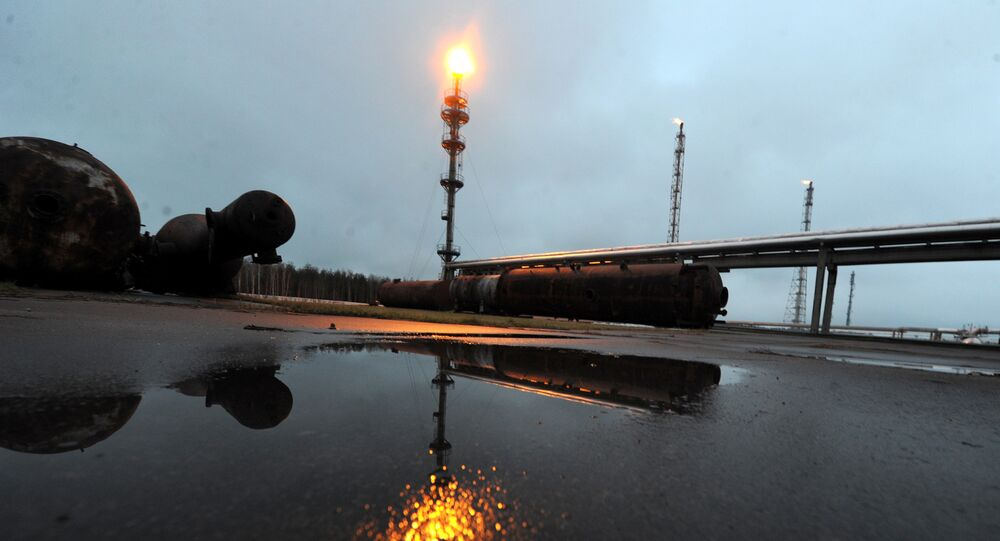Casing-head gas flares on a stack at the Mozyr oil refinery some 300 km south of Minsk in Mozyr on January 4, 2013