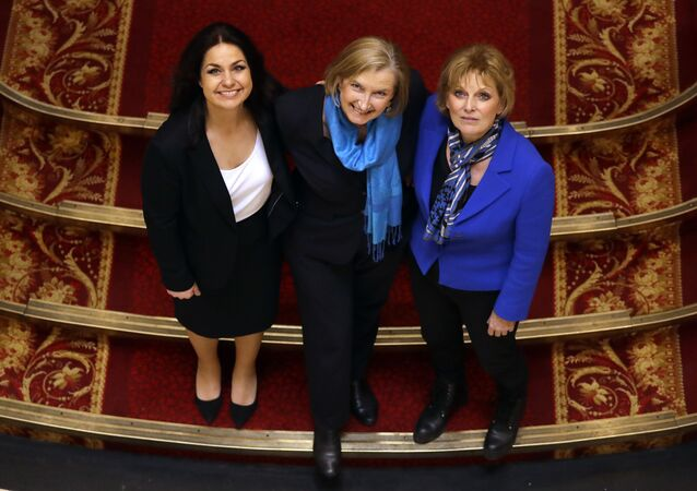 British politicians Heidi Allen, left, Sarah Wollaston, centre, and Anna Soubry, right, joined new political party 'The Independent Group' pose for a photograph after a press conference in Westminster in London, Wednesday, Feb. 20, 2019.