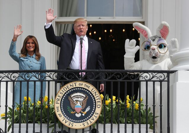 U.S. President Donald Trump and first lady Melania Trump wave beside a person in an Easter Bunny costume on the Truman balcony of the White House during the 2019 White House Easter Egg Roll in Washington, U.S., April 22, 2019
