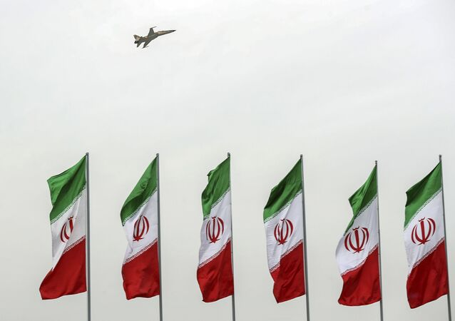 In this photo released by the official website of the office of the Iranian Presidency, a fighter jet flies over Iranian flags during the army parade commemorating National Army Day in front of the shrine of the late revolutionary founder Ayatollah Khomeini, just outside Tehran, Iran, Thursday, April 18, 2019