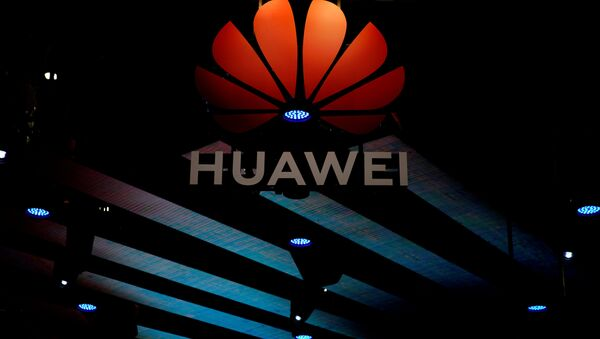 A Huawei logo is pictured during the media day for the Shanghai auto show in Shanghai, China April 16, 2019 - Sputnik International