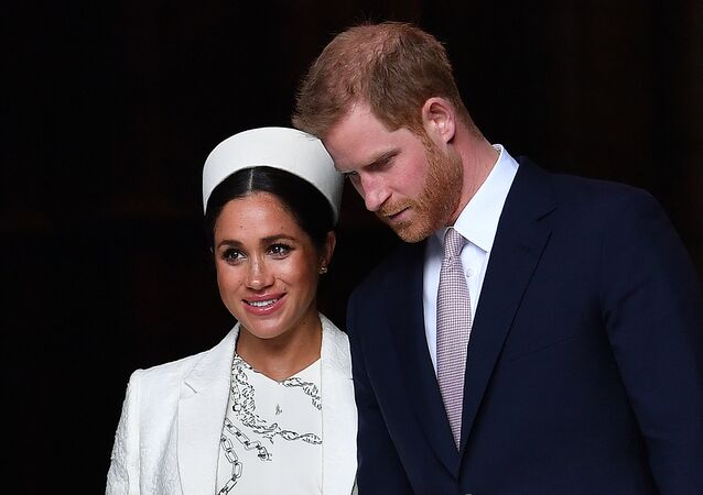 In this file photo taken on March 11, 2019 Britain's Prince Harry, Duke of Sussex (R) and Meghan, Duchess of Sussex leave after attending a Commonwealth Day Service at Westminster Abbey in central London