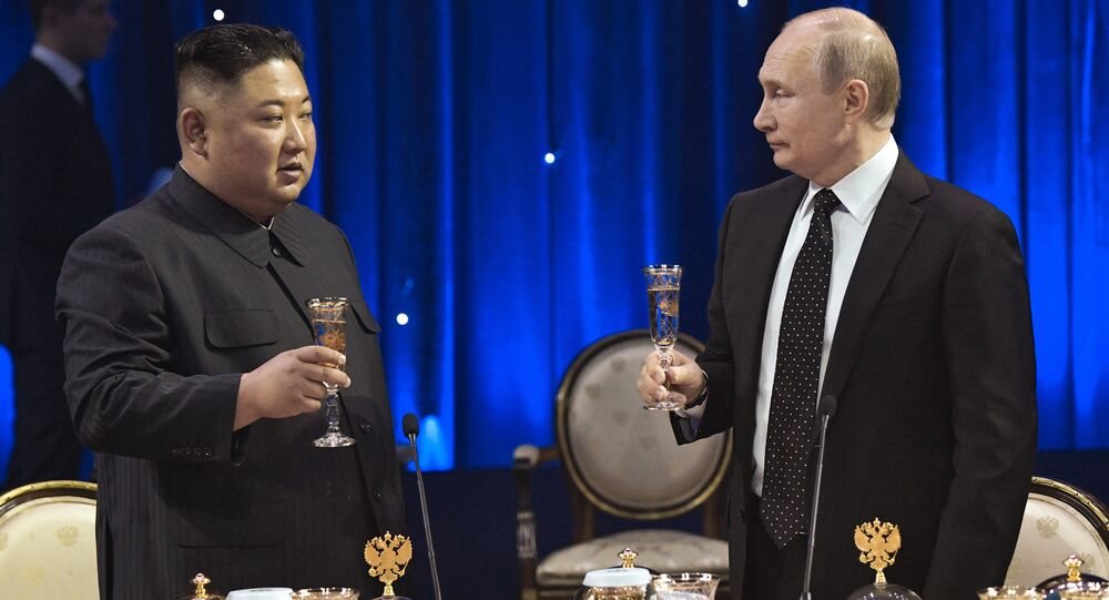 Russian President Vladimir Putin toasts with North Korean leader Kim Jong Un at a reception after their talks at the Far Eastern Federal University campus on Russky Island in Vladivostok, Russia