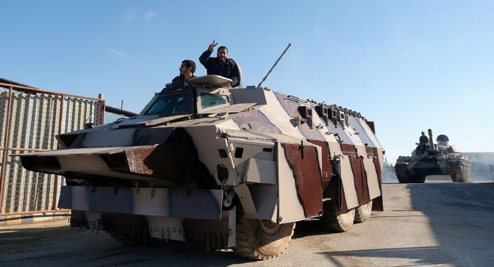 Members of Libyan National Army (LNA) commanded by Khalifa Haftar, get ready before heading out of Benghazi to reinforce the troops advancing to Tripoli, in Benghazi, Libya April 13, 2019