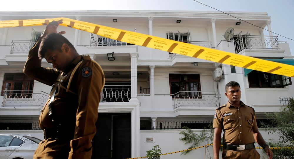 Police keep watch outside the family home of a bomber suspect where an explosion occurred during a Special Task Force raid, following a string of suicide attacks on churches and luxury hotels, in Colombo, Sri Lanka April 25, 2019.