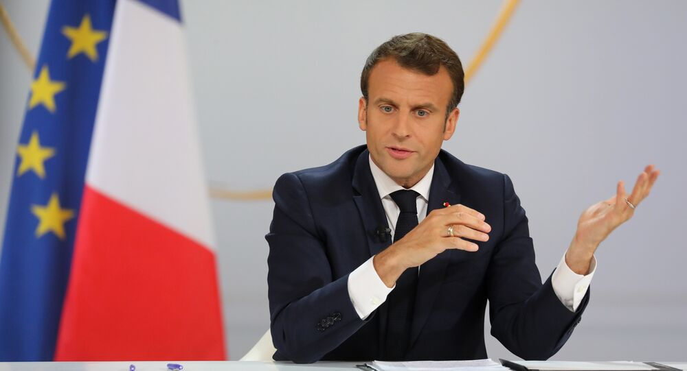 French President Emmanuel Macron gestures during his live address following the Great National Debate, at the Elysee Palace in Paris on April 25, 2019. President Emmanuel Macron on April 25, 2019 vowed to press ahead with his government's programme to transform France, adding public order must be restored after months of protests.