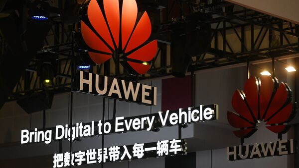 Signs are displayed at the Huawei stand at the Shanghai Auto Show in Shanghai on April 17, 2019 - Sputnik International