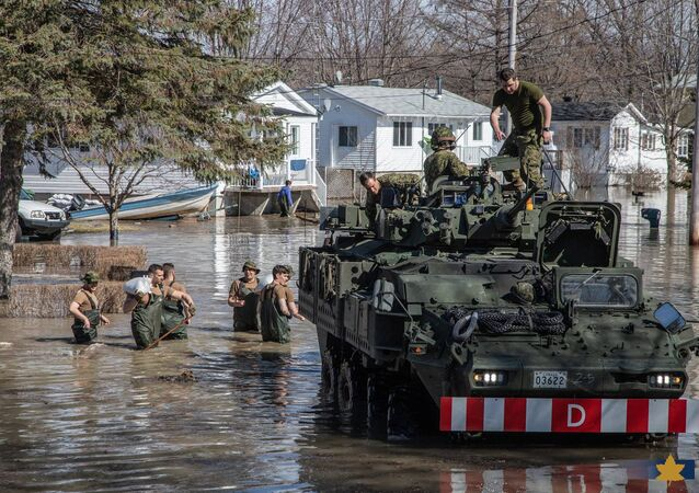 Soldiers from the 2nd Canadian Division of the Canadian Armed Forces from Quebec assist sandbagging and other efforts during a response to natural disasters in Maskinonge, Quebec, Canada April 21, 2019