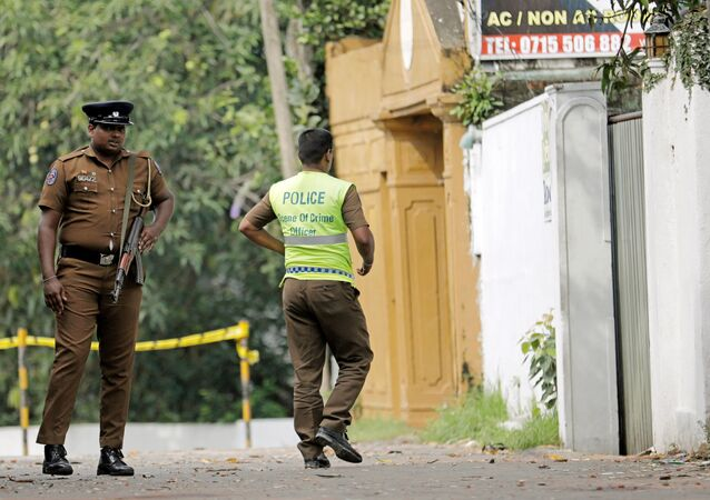 A Sri Lankan police officer walks into the motel where the Australian and British-educated suicide bomber had detonated his device inside, in Dehiwala on the outskirts of Colombo, Sri Lanka April 26, 2019.