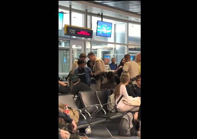 North Carolina woman Rosetta Swinney is arrested in Las Vegas after being removed from a Frontier flight to Raleigh-Durham International Airport for refusing to allow her daughter to sit in a seat tainted with vomit April 20, 2019.
