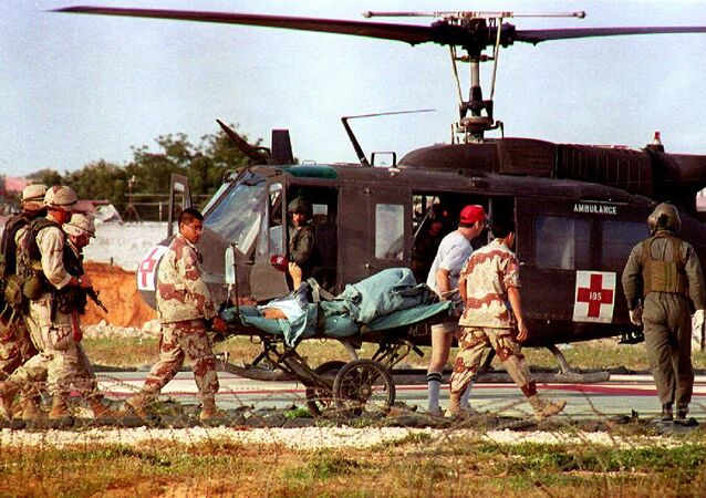 US helicopter pilot Michael Durant is carried on a stretcher to the helicopter from the 46th Combat Support hospital.