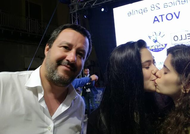 Matilde Rizzo and Gaia Parisi are kissing as Italian Interior Minister Salvini is taking a selfie at a rally in support of Oscar Aiello's bid for mayor of Caltanissetta