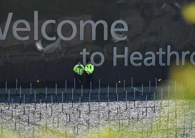 Police officers stand guard near the entrance to Terminal 2 and 3 close to where climate change activists held a demonstration outside Heathrow Airport in west London on April 19, 2019 during the fifth day of an environmental protest by the Extinction Rebellion group.