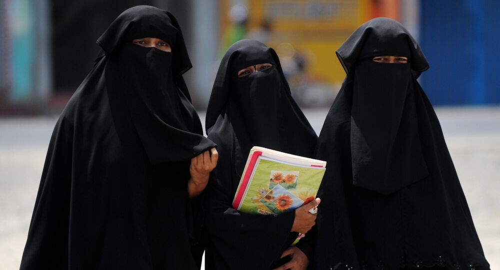 Sri Lankan Muslim girls wearing the hijab, walk through the streets of the eastern town of Kattankudi in Batticaloa on May 20, 2011.