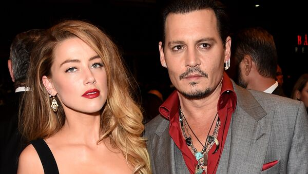 Actors Amber Heard (L) and Johnny Depp attend the Black Mass premiere during the 2015 Toronto International Film Festival at The Elgin on September 14, 2015 in Toronto, Canada. - Sputnik International