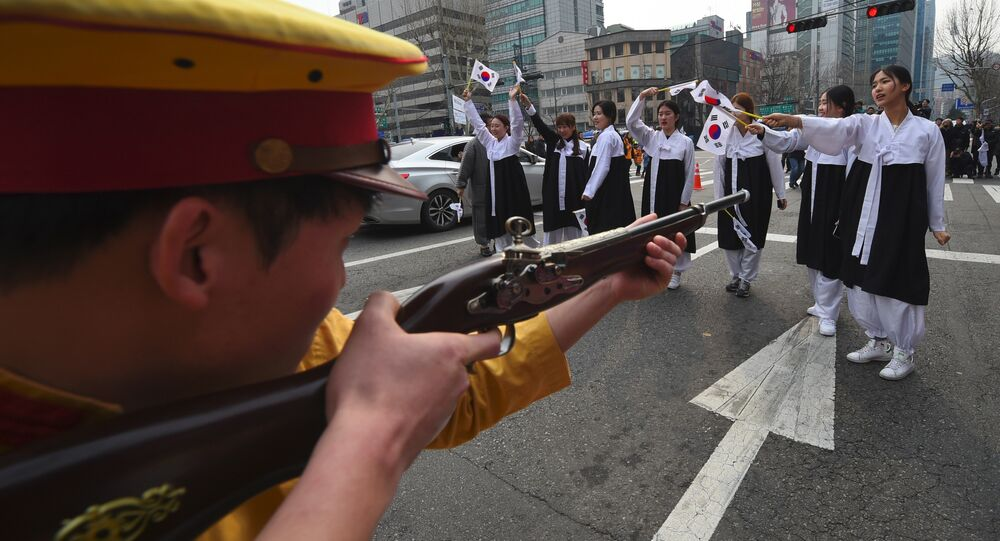 South Korean activists dressed as colonial-era Japanese soldiers reenact a crackdown of the independence movement during celebrations of the 98th Independence Movement Day in Seoul on March 1, 2017