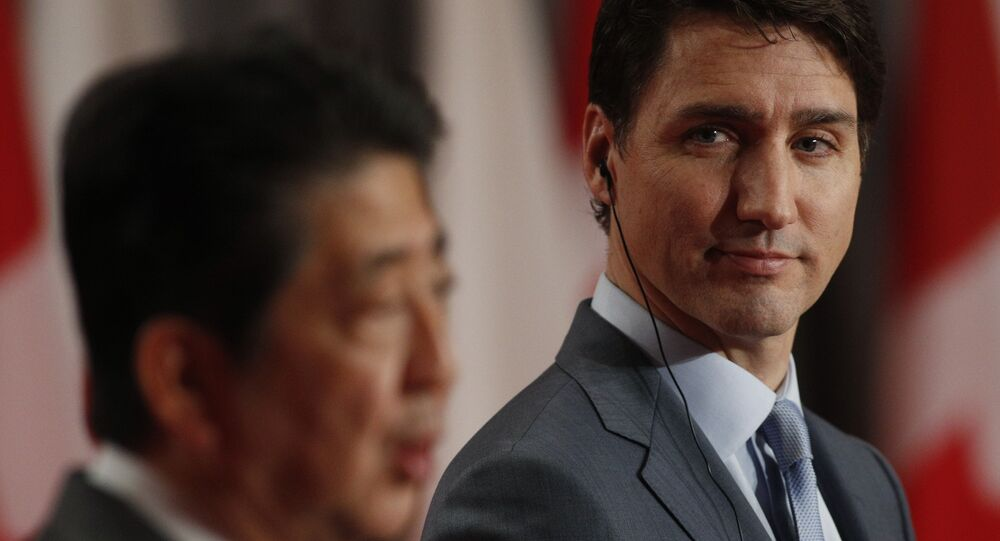 Japanese Prime Minister Shinzo Abe and Canadian Prime Minister Justin Trudeau answer questions during a joint media availability in Ottawa, Ontario, on April 28, 2019.