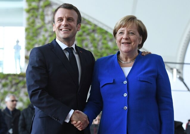 German Chancellor Angela Merkel welcomes French President Emmanuel Macron before a meeting with Western Balkans leaders, at the Chancellery in Berlin, Germany, April 29, 2019.