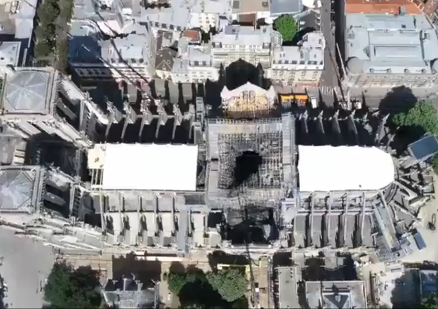 A drone video by Paris Prefecture de Police shows Notre Dame cathedral's roof secured following a massive fire two weeks prior