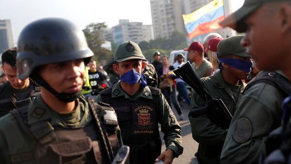 Military members stand near the Generalisimo Francisco de Miranda Airbase La Carlota, in Caracas, Venezuela April 30, 2019 - Sputnik International