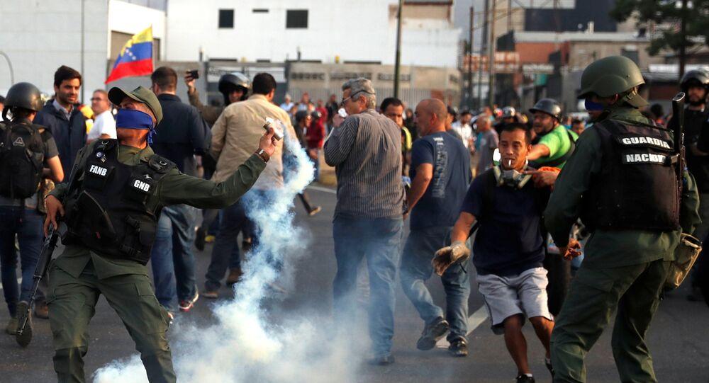 A military member throws a tear gas canister near the Generalisimo Francisco de Miranda Airbase La Carlota, in Caracas, Venezuela April 30, 2019
