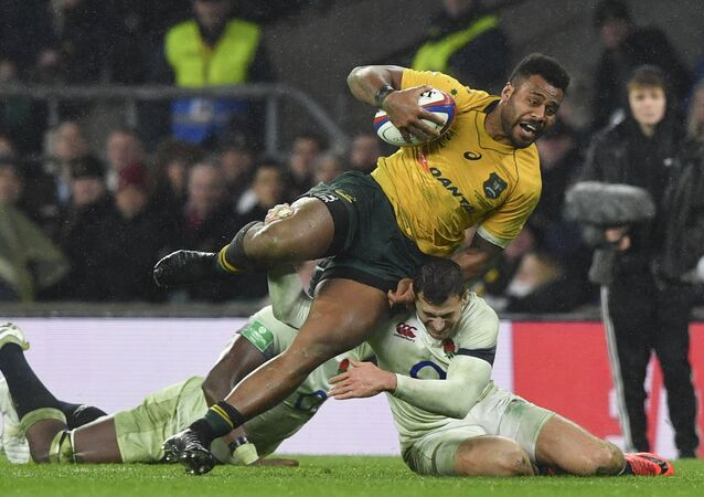 Australia's centre Samu Kerevi is tackled by England's Maro Itoje (L) and England's wing Jonny May (R) during the international rugby union test match between England and Australia at Twickenham stadium in south-west London on November 18, 2017