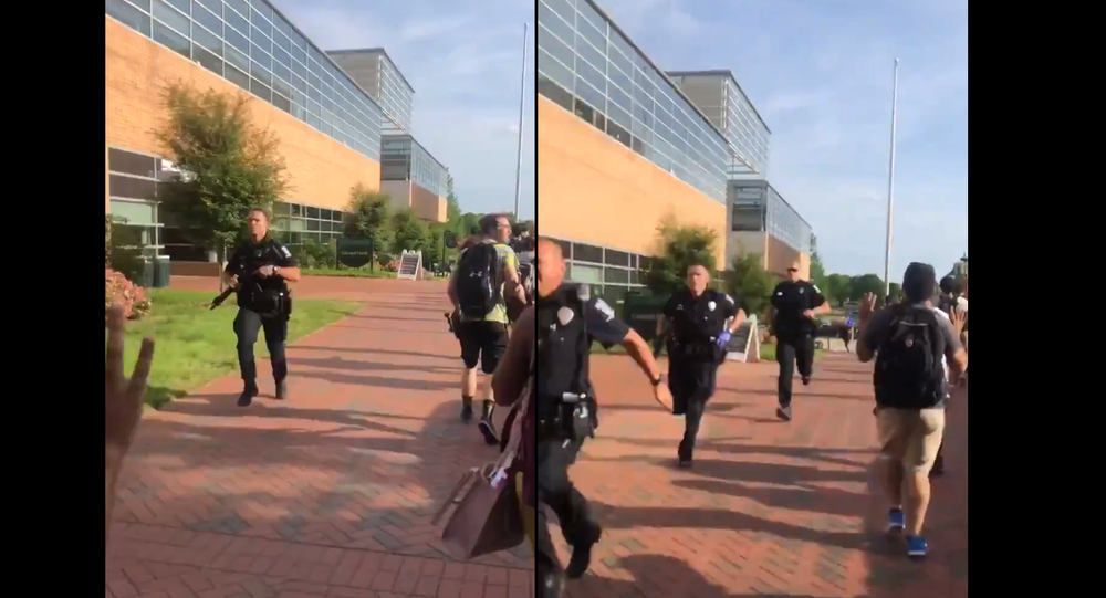 Multiple police officers rush campus of UNC-Charlotte following shooting, April 30, 2019