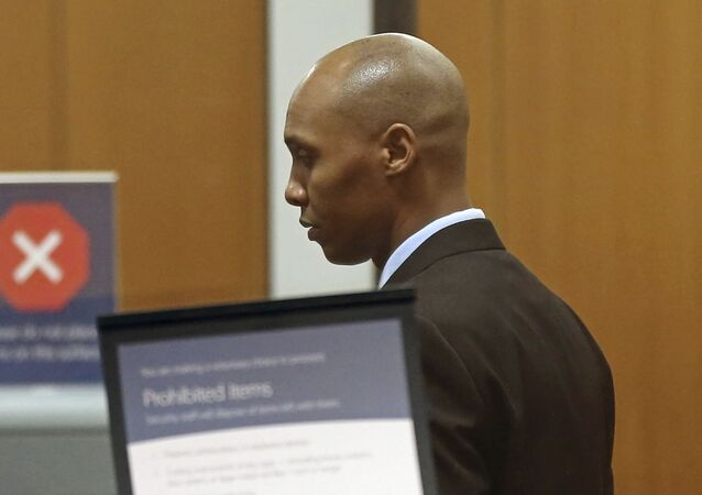 Mohamed Noor, the former Minneapolis police officer waits to go through security at the Hennepin County Government Center Thursday, April 25, 2019 in Minneapolis in the fourth week of his trial. Noor is charged with second-degree intentional murder, third-degree murder and second-degree manslaughter in the July 15, 2017, shooting death of Justine Ruszczyk Damond, a 40-year-old life coach and Australian-American who had called 911 to report a possible sexual assault behind her home.