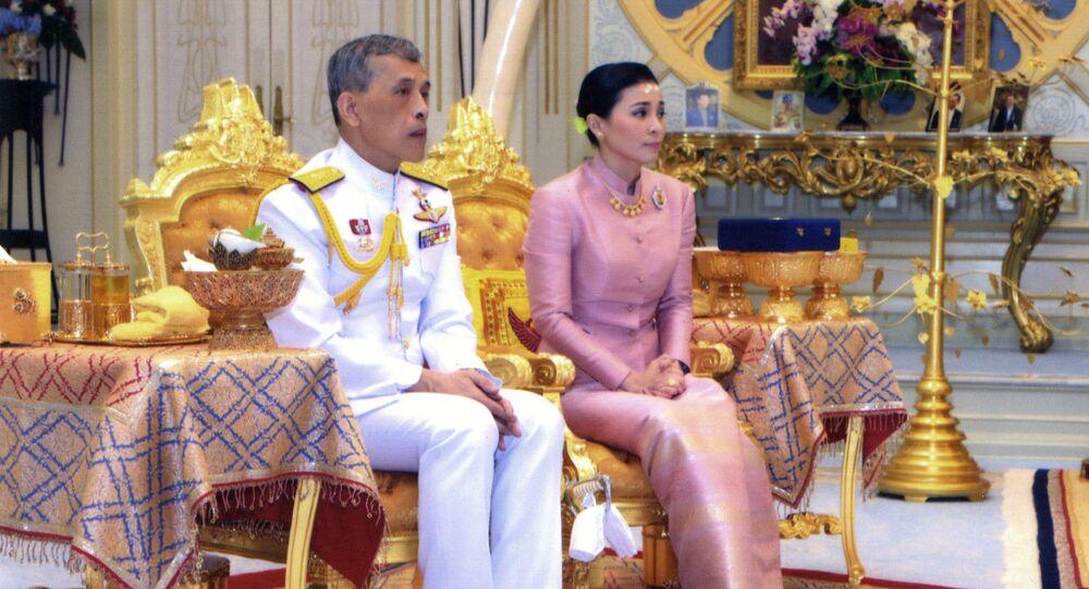 In this photo released by Bureau of the Royal Household ,Thailand's King Maha Vajiralongkorn Bodindradebayavarangkun, left, sits with Queen Suthida Vajiralongkorn Na Ayudhya at Ampornsan Throne Hall in Bangkok, Thailand, Wednesday, May 1, 2019.