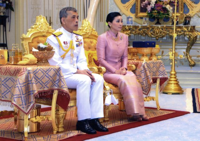 In this photo released by Bureau of the Royal Household ,Thailand's King Maha Vajiralongkorn Bodindradebayavarangkun, left, sits with Queen Suthida Vajiralongkorn Na Ayudhya at Ampornsan Throne Hall in Bangkok, Thailand, Wednesday, May 1, 2019.