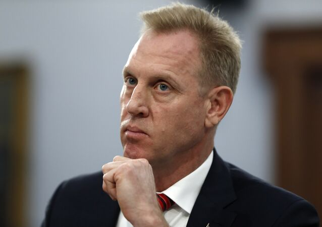 Acting Defense Secretary Patrick Shanahan listens, Wednesday May 1, 2019, during a House Appropriations subcommittee on budget hearing