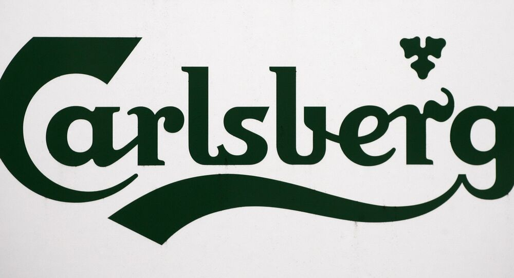 A Carlsberg logo is pictured on a signboard at the brewery in Leeds in west Yorkshire in northeast England, on November 5, 2008