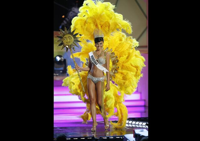 FILE - In this July 18, 2006 file photo, Miss Uruguay, Fatimih Davila, shows off a costume related to her home country during the preliminary competition for Miss Universe 2006 at the Shrine Auditorium in Los Angeles. Davila was found dead at a Mexico City hotel. City prosecutors said she was found hanged in the bathroom of one of the hotel's rooms early Thursday, May 2 2019.