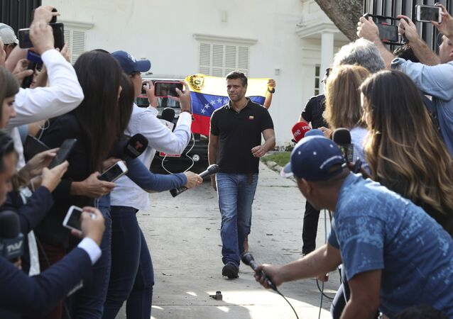 Venezuelan opposition leader Leopoldo Lopez walks to gate of the Spanish ambassador's residence in Caracas to speak with the press, in Venezuela, Thursday, May 2, 2019