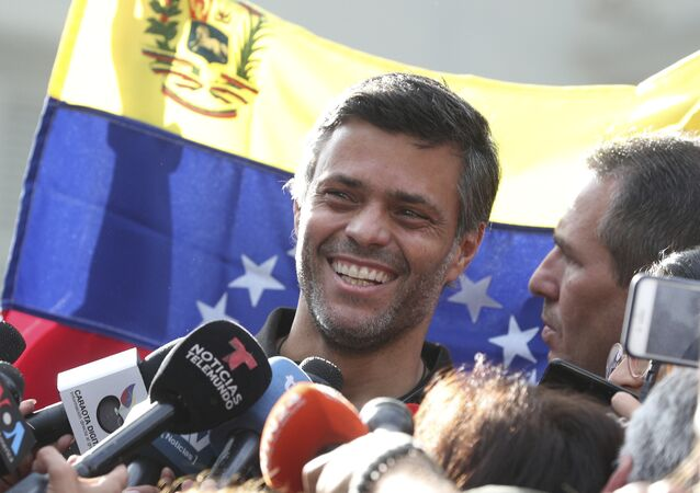 Venezuelan opposition leader Leopoldo Lopez smiles during a press conference at the gate of the Spanish ambassador's residence in Caracas, Venezuela, Thursday, May 2, 2019
