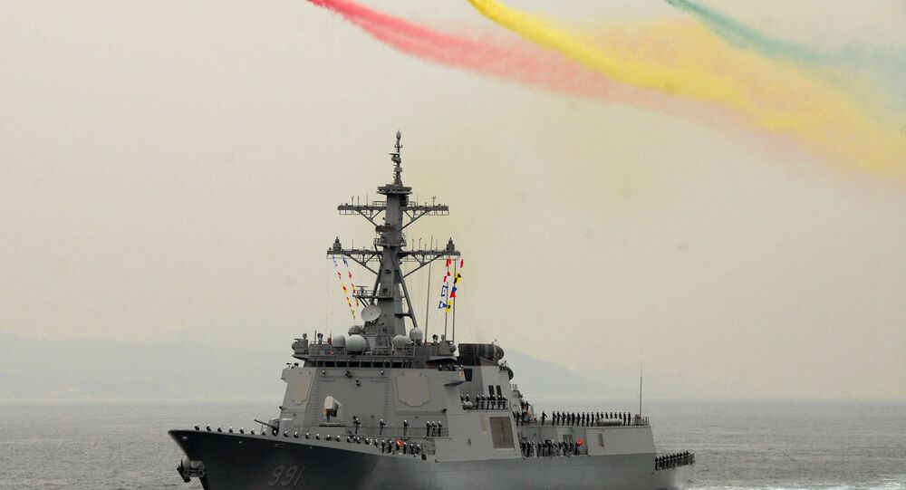 Helicopters fly over the Republic of Korea Aegis destroyer Sejong the Great (KDX 991) during the International Fleet Review Pass and Review. The International Fleet Review, which runs from Oct. 5 through Oct. 10, celebrates the 60th anniversary of the Republic of Korean.